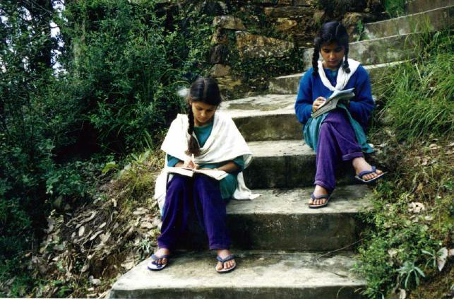 The girls often do their homework in the open air